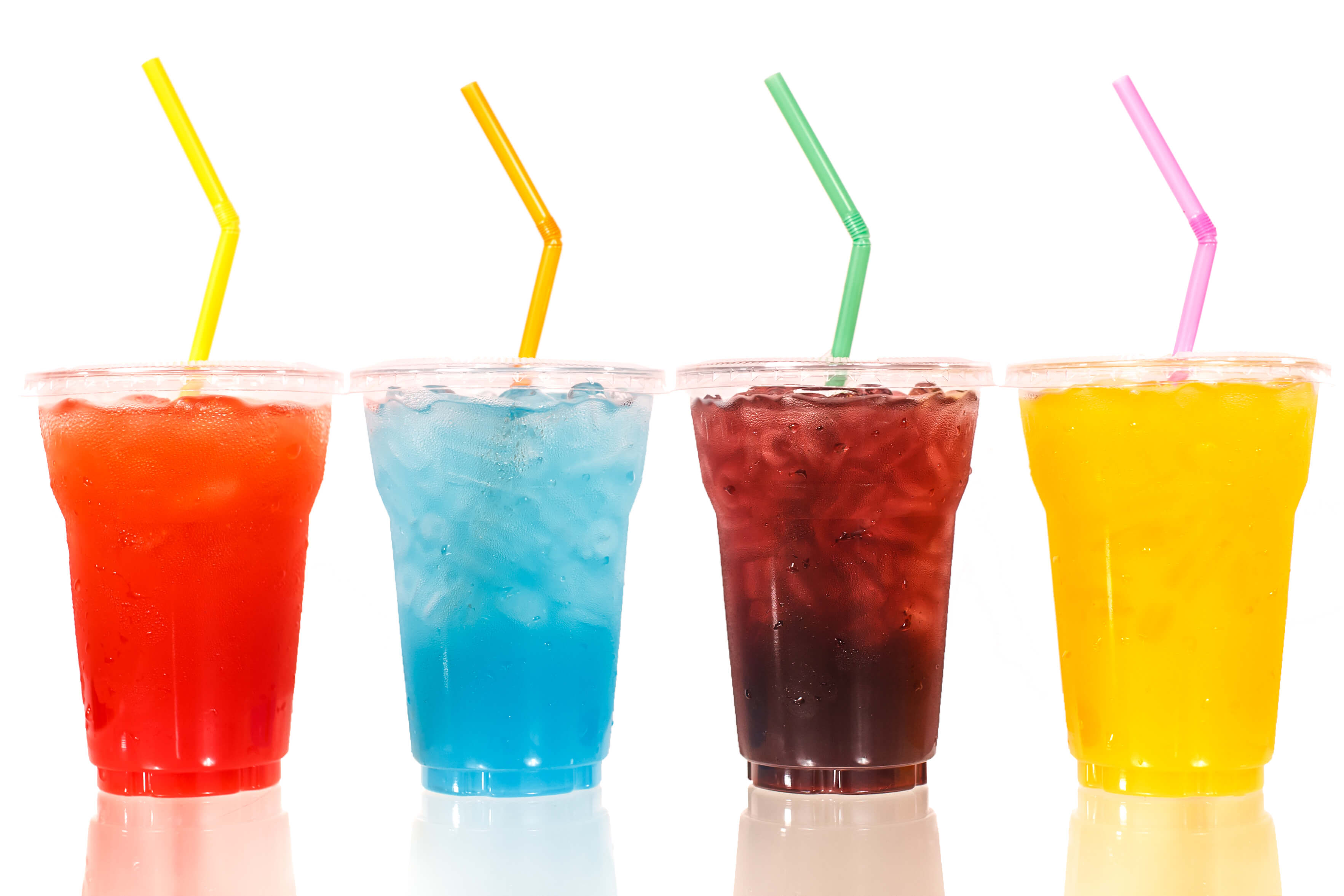 Multi-color cool soft drink with straw on isolated white background